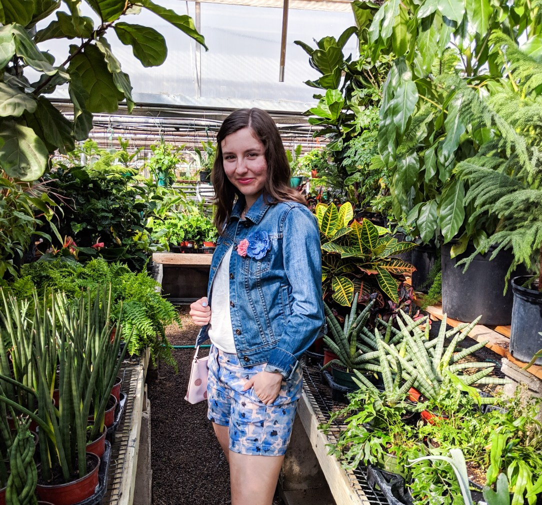 blue floral shorts from Loft, denim jacket, greenhouse photos, floral pins