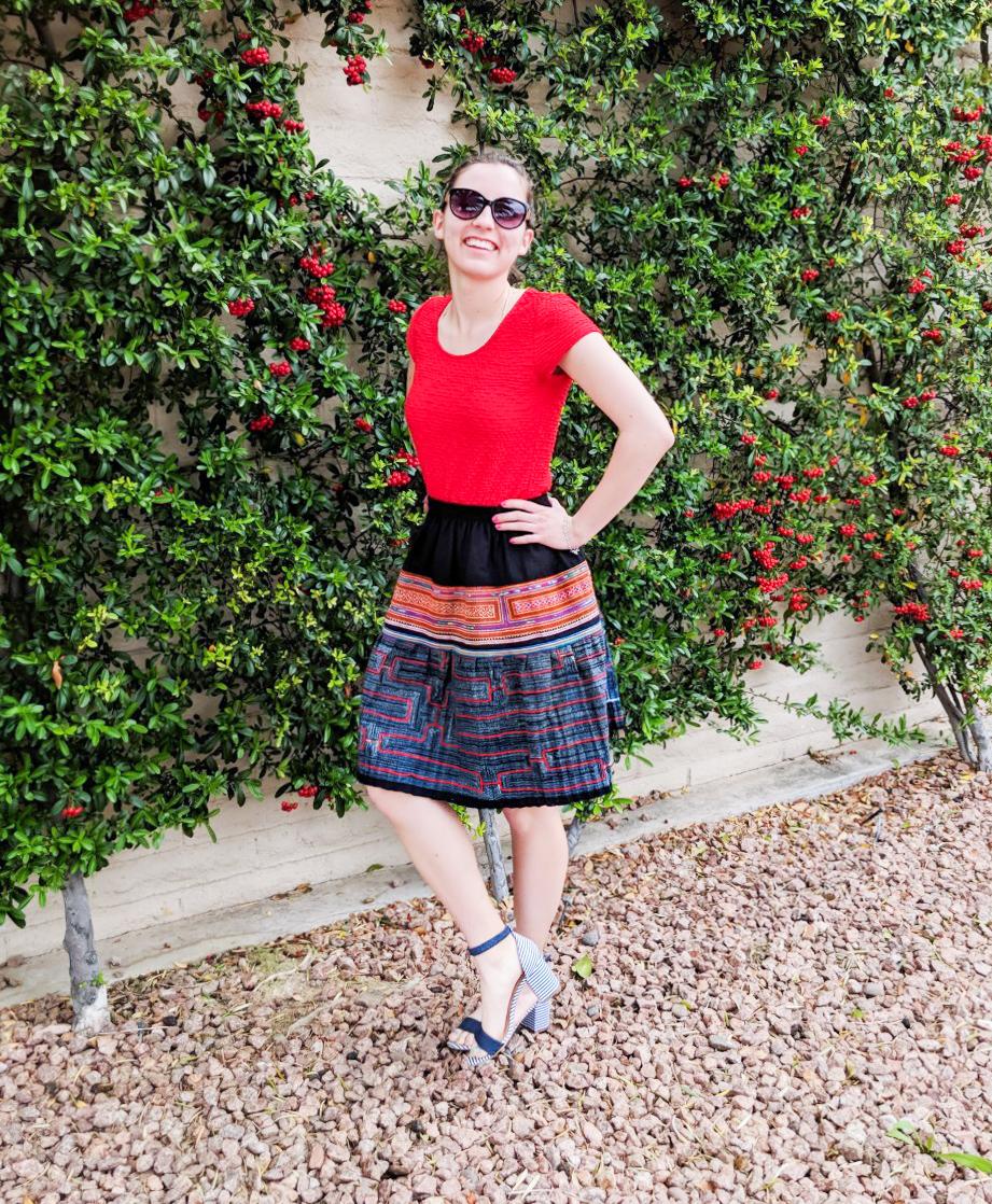 red shirt, patterned fair trade skirt, striped heels