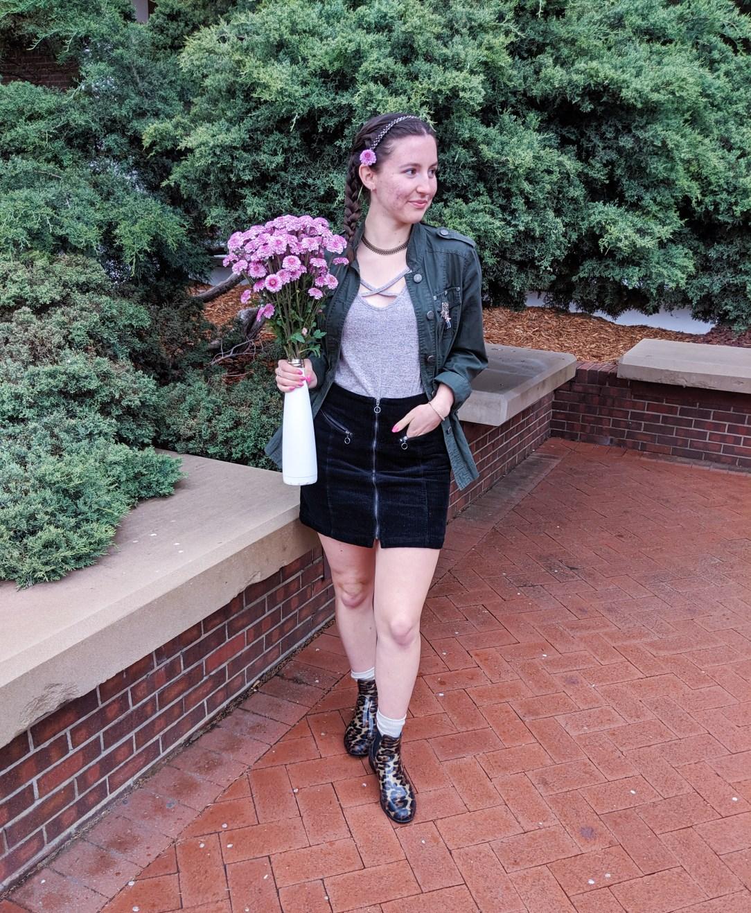 pink flowers, leopard rain booties, black skirt, blush top, green military jacket