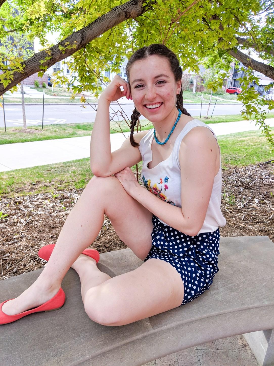 orange flats, polka dot shorts, turquoise necklace