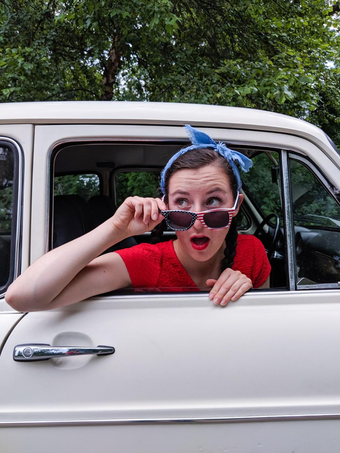 patriotic sunglasses, blue bandanna, old car, red lipstick