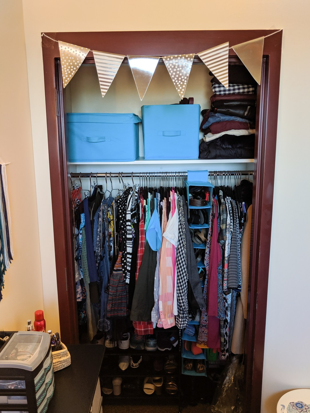 organized dorm room closet
