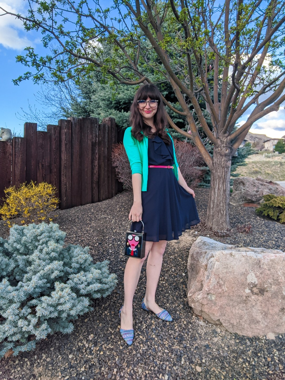 navy dress, dorsay flats, box purse, green cardigan
