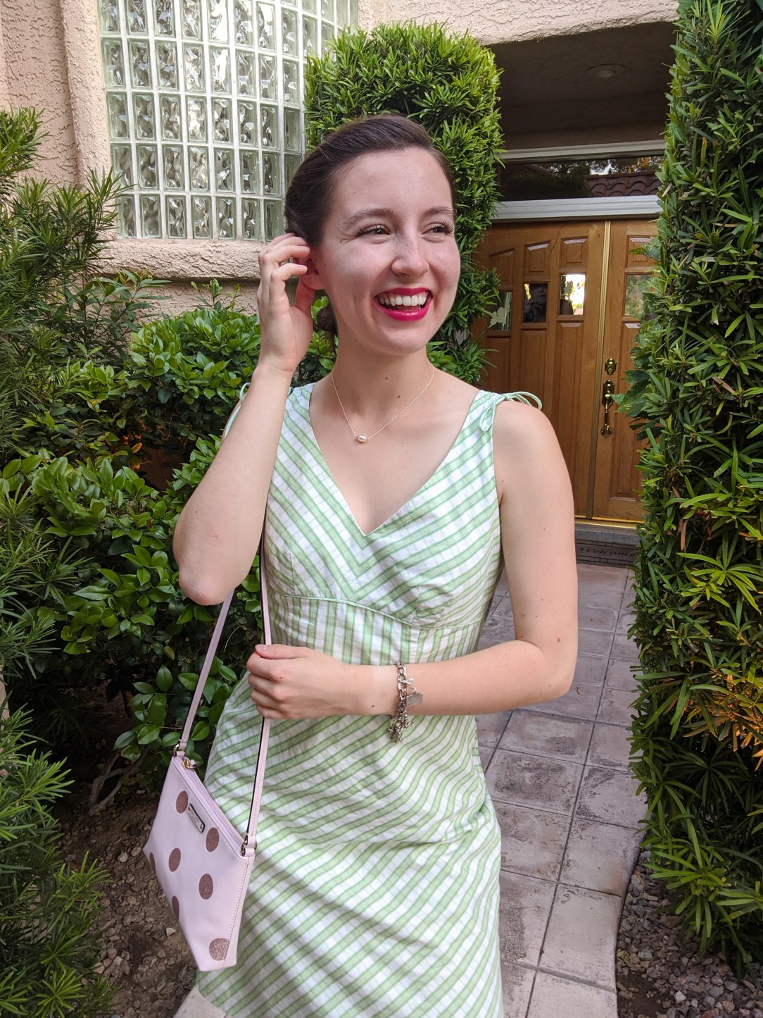 pearl-necklace-red-lipstick-retro-hairstyle-green-sundress