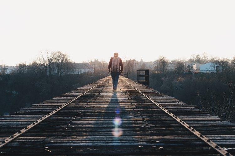 guy on tracks alone