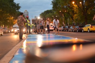 """Mat Tomezsko and volunteers install Tomezsko's mural """"14 Movements: A Symphony in Color and Words"""" along Broad Street's median during July.   THE TEMPLE NEWS"""