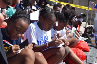 A group of girls participate in the organization Mighty Writers' attempt to break a Guinness World Record during July.   THE TEMPLE NEWS
