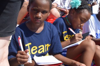 A young girl at the organization Mighty Writers' attempt to break a Guinness World Record during July.   THE TEMPLE NEWS