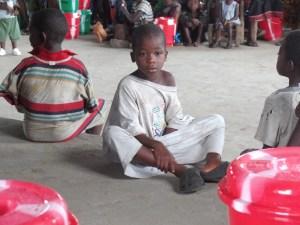 Children awaiting buckets and meds.