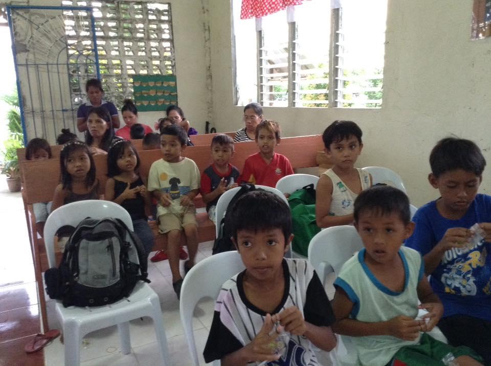 Philippine Kids Making Bracelets.jpg
