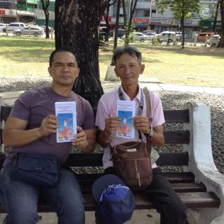Roel and Benjamin with Brochures