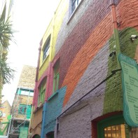 A brightly coloured wall somewhere (I have no idea where we were at the time!)
