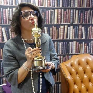 Gracie Opulanza holding an Oscar