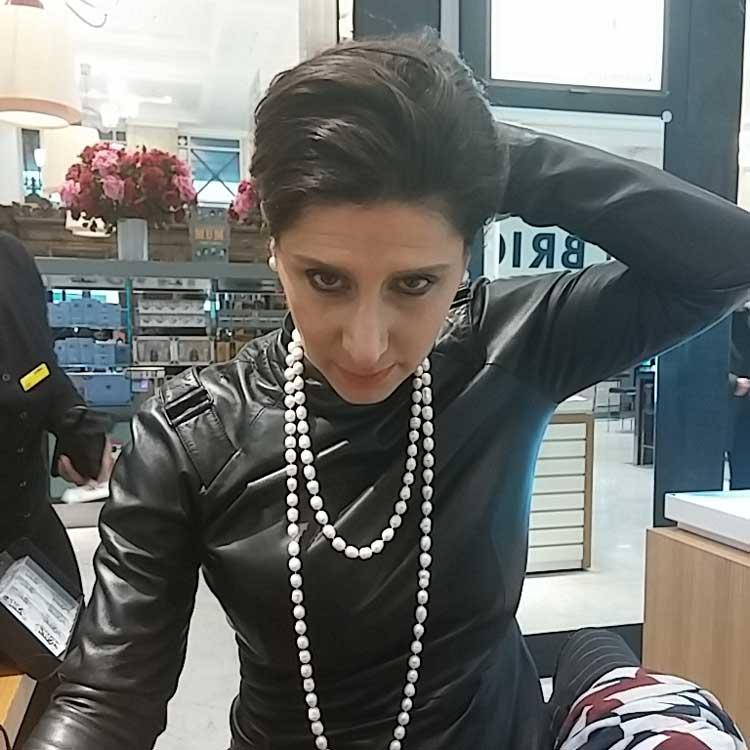 gracie-opulanza-wearing-black-leather-dress
