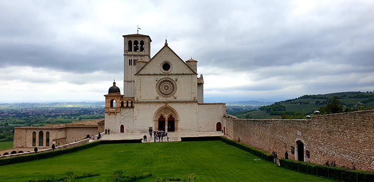 fresco-secco or secco mural painting techniques, which are applied to dried plaster Assisi