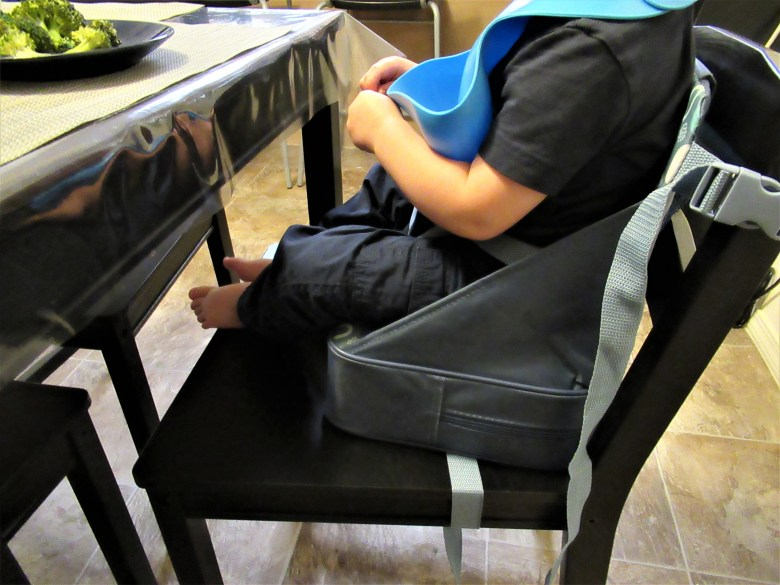 I love this portable booster seat I found for my toddler!