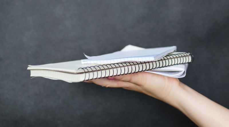 person holding notebook