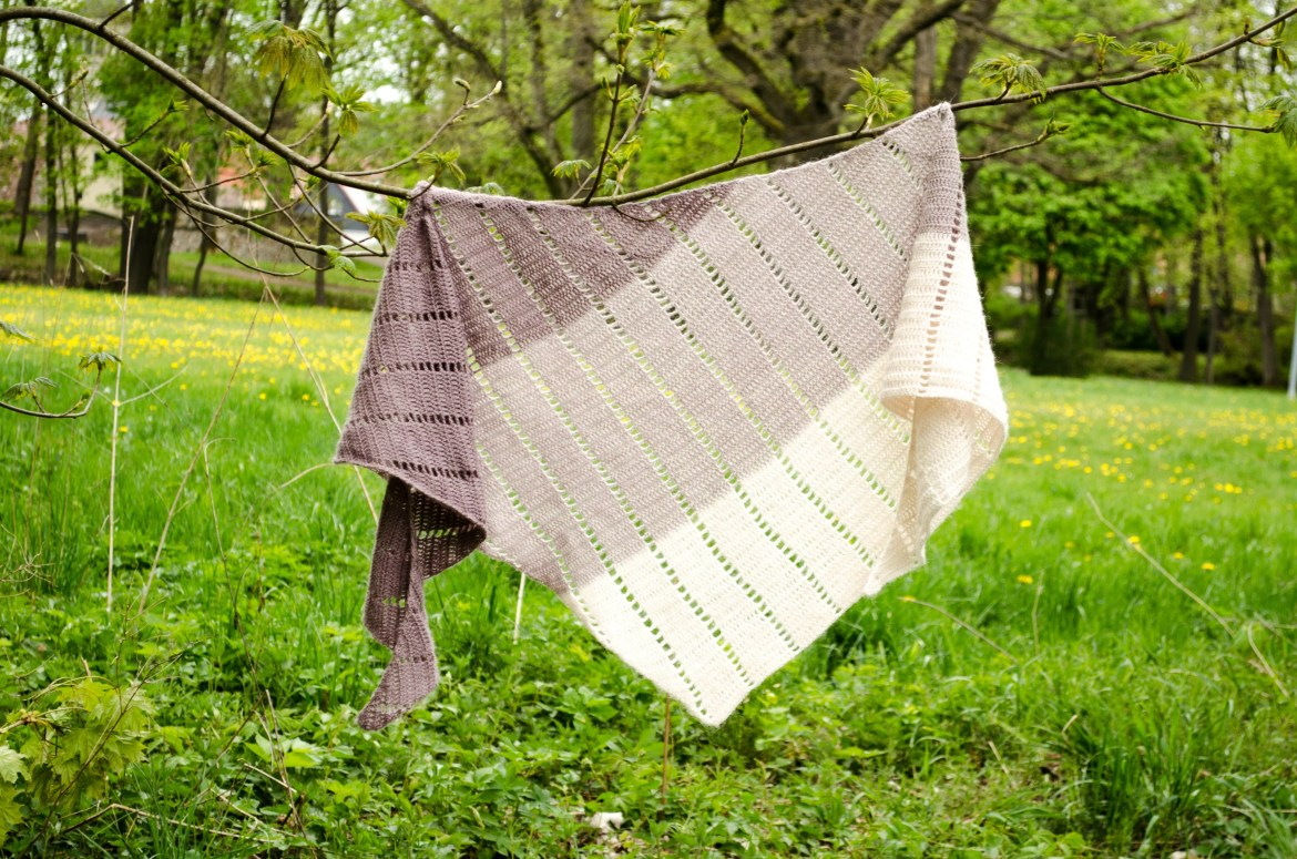 Draped shawl hanging on two branches