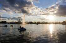 Paddleboat riders watch as the sun begins to set over the Georgia National Fair in Perry, Georgia, on Saturday, October 10, 2015. (Photo/Savanna Sturkie, ssturkie@uga.edu)