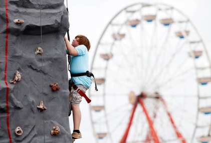 Dylan Purvis, an 11-year-old from Wheeler County, Georgia, scales a rock climbing wall at the Georgia National Fair, on October 7, 2017, in Perry, Georgia. (Photo/Christina R. Matacotta)
