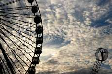 A performer from The Nerveless Nocks All-American Daredevil Stunt Show stands 50 feet in the air on a double steel wheel at the Georgia National Fair in Perry, Georgia on Saturday October 7, 2017. The double wheel of steel acts as a teeter-totter, where neither person is strapped in. (Photo/Heather Bryan)