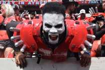 Langston Leake, 21, a history and political science major at the University of Georgia, participates as a member of the Spike Squad during the Georgia vs. Tennessee football game at Sanford Stadium, on September 29, 2018. Sitting field-level at Sanford Stadium, Leake chants and shouts aggressively and dons themed paint, spiked shoulder pads and other costume pieces to cheer for the dogs.