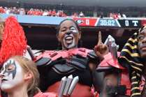 """Sydney Guion, 18, a public relations major at the University of Georgia, participates as a member of the Spike Squad during the Georgia vs. Tennessee football game at Sanford Stadium, on September 29, 2018. Sitting field-level at Sanford Stadium, Guion yells for the dogs and dons canine themed paint and spiked shoulder pads to cheer for the dogs. Guion says she joined Spike Squad because she """"loves school spirit and supporting the Dawgs!"""""""