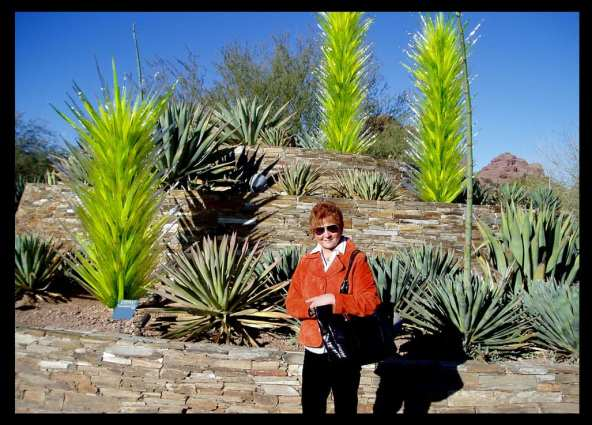 JAN IN THE REAL AND GLASS AGAVES BY DALE CHIHULY