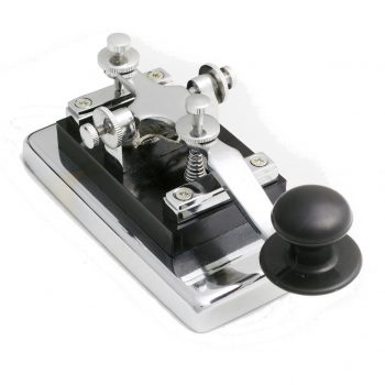 vintage morse telegraph key with white background