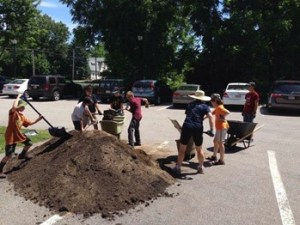 Soil delivery, 2015; volunteers help to relocate and fill raised beds.
