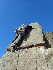 Dave making the final moves onto the top block of the Napes Needle