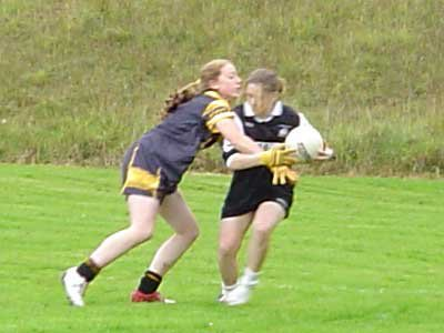 Grainne Mhaols corner forward Danielle Lydon comes in for some close attention from her opposite marker in this incident from the 2004 Connacht Junior Championship Semi Final.