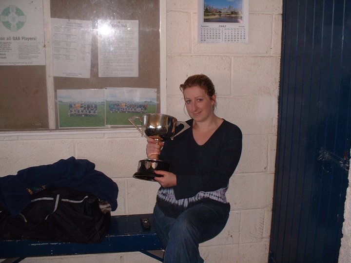 Linda O Malley poses with the Junior B Championship Cup after Grainne Mhaols historic victory over Milltown in the 2002 final at Headford.