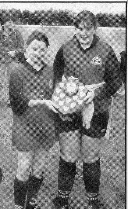 Eagles Nest Joint Captains Chloe Walsh and Patricia Flaherty pose proudly with the Victory Shield after their side defeated Garrafrauns in the 2002 County 9 A Side Final in Renmore.