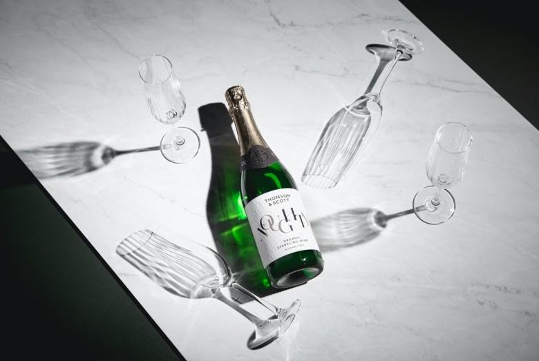 Thomson & Scott Amanda Thomson Noughty organic vegan alcohol-free sparkling chardonnay wine glass wine bottle