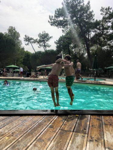 Jumping for joy into the pool at our campsite