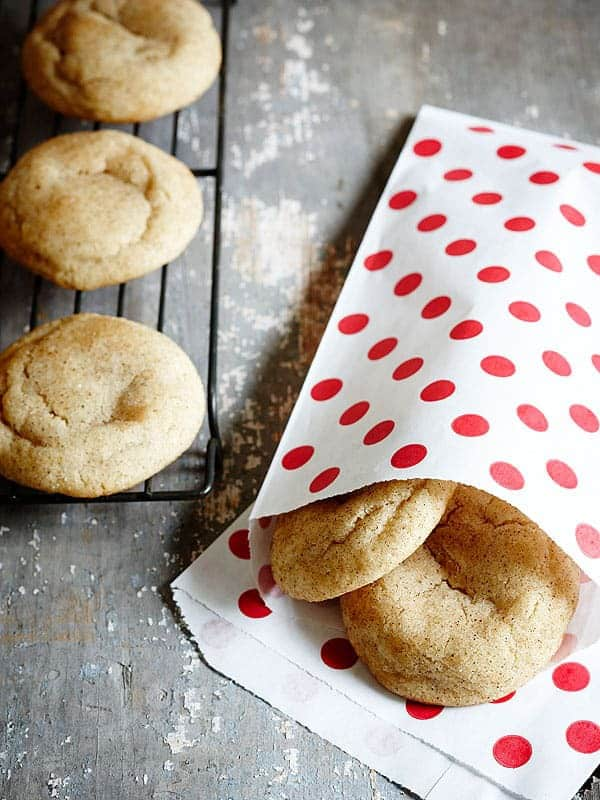 Chai Brown Butter Snickerdoodles in a white and red polka dot bag with cookies on cooling rack ready to serve