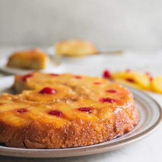 Pineapple Upside Down Cake Recipe -This is the best pineapple cake recipe online! It's a moist sponge cake caramelized to perfection with brown sugar pineapple rings and cherries. #pineapple #cherries #upsidedown #upsidedowncake #cake
