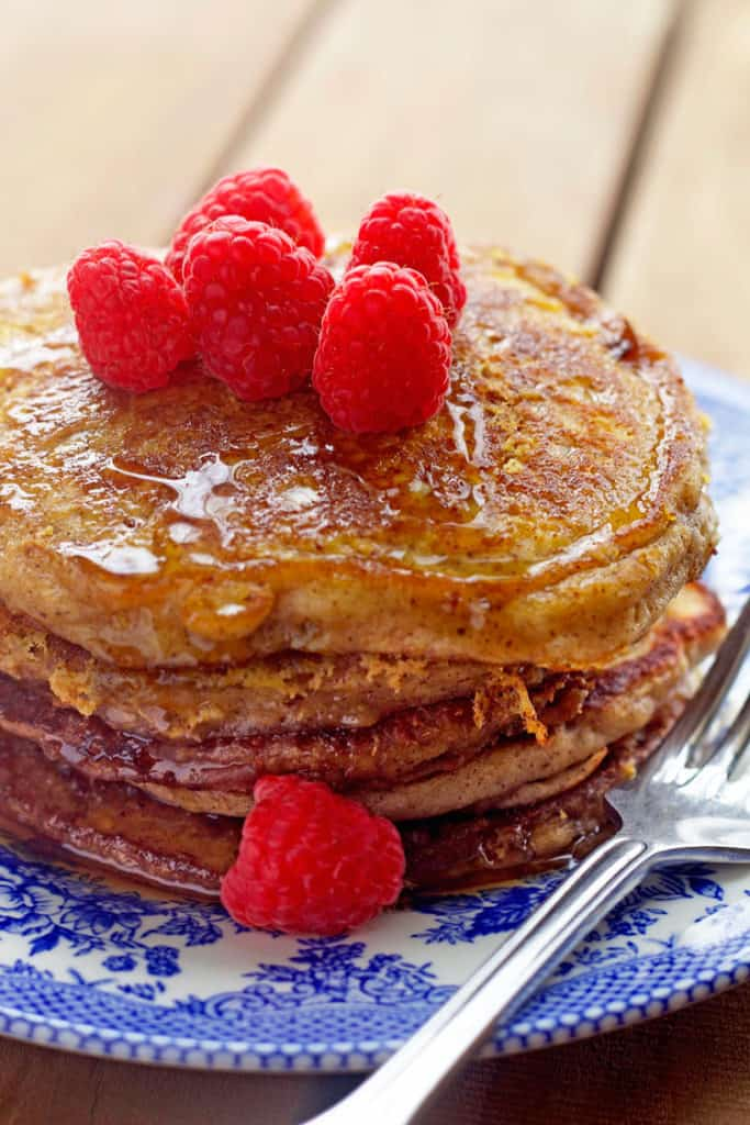 Delicious stack of french toast pancakes recipe with syrup and raspberries ready to serve