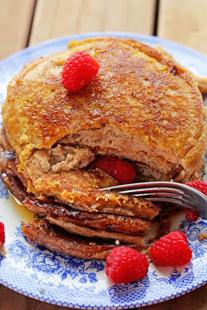 A stack of french toast pancakes recipe being eaten with fork