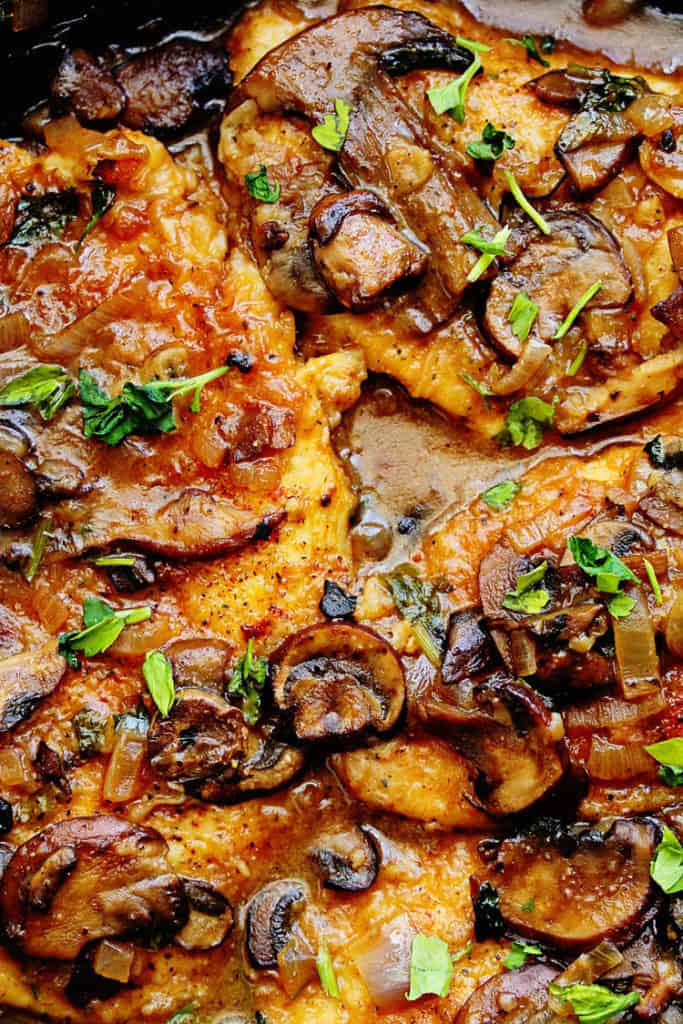 A classic Healthy Dinner Recipe of Chicken Marsala close up overhead