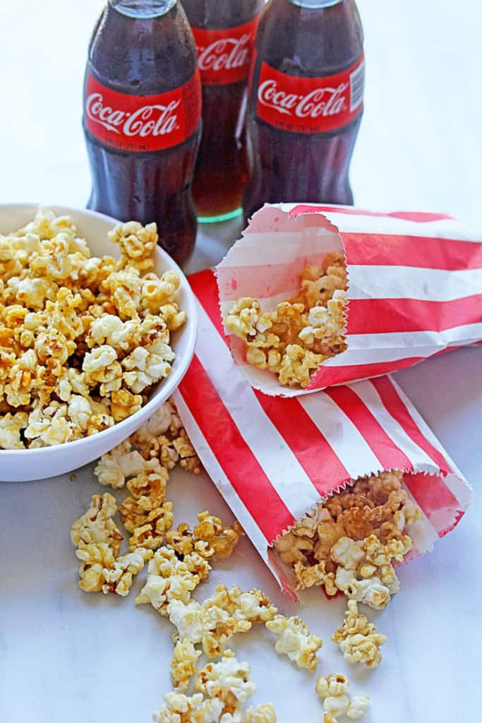 Decadent, delicious and easy Coke Caramel Popcorn ready to make all your snack dreams a reality. It's one of the best combinations of Coke and Popcorn ever!!