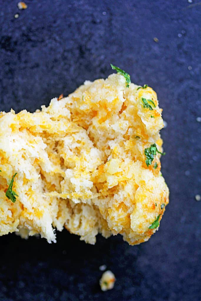 Cheddar Bay Biscuit recipe opened to show cheesy center (Homemade Garlic Cheddar Buttermilk Biscuits)