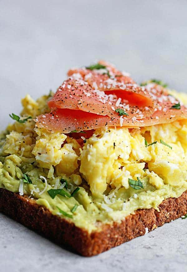 Avocado Toast Recipe topped with scrambled eggs and salmon.