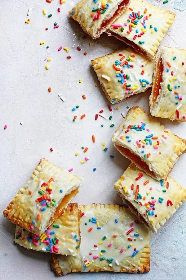 Homemade Pop Tarts piled on top of each other and cut in half so you can see the filling inside.