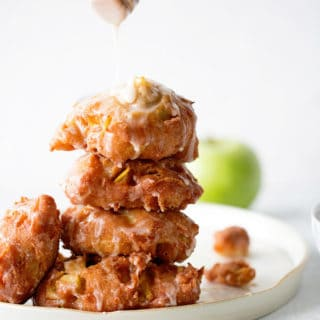 Apple Fritters Recipe - Pieces of delicious Granny Smith apples wrapped and fried in sugary dough will send your taste buds into food heaven! The best apple fritters you'll ever eat.