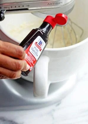 Vanilla being poured in batter for Cheesecake