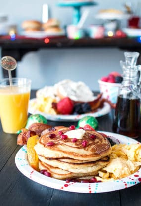 Ginger Orange Pancakes recipe on plate with eggs and bacon with juice in background ready to serve