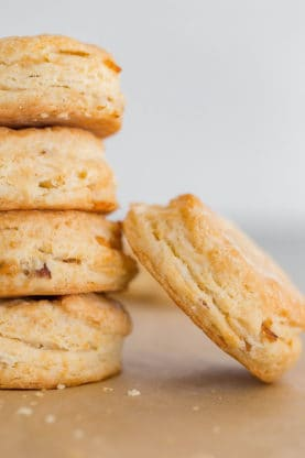 A close up of Cheddar Biscuits stacked and ready to serve