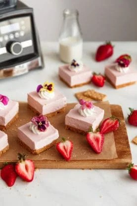 No Bake Strawberry Cheesecake Recipe - The easiest and most delicious spring for strawberry cheesecake bars fit for any celebration. The filling is absolutely sensational and tastes just like strawberry ice cream. Addictive!